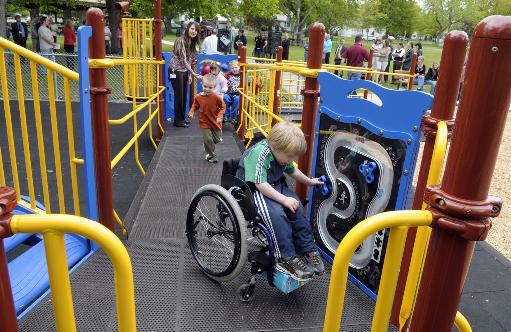 Caleb Ross is one of the first kids to use the new playground at Mission Park Tuesday May 25, 2010. The equipment is accessible for children in wheelchairs and walkers and features a rubberized tile ground cover. CHRISTOPHER ANDERSON chrisa@spokesman.com